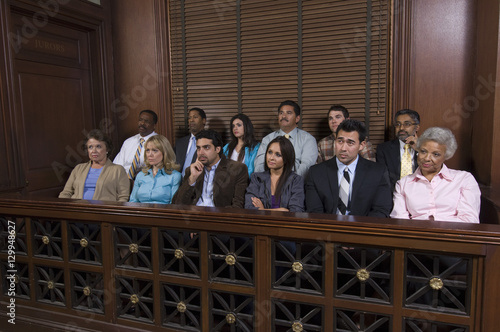 Fototapeta Group of jurors sitting together in jury box during trial