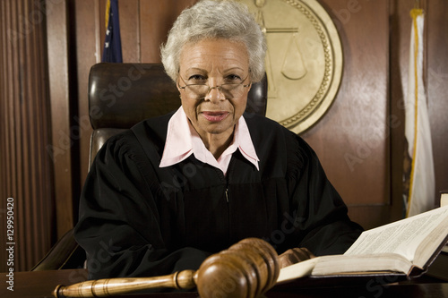 Portrait of a senior female judge with book in courtroom Fototapeta