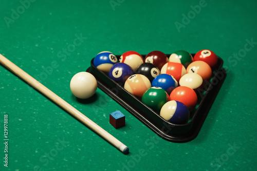 Billiard balls near by cue and chalk. Fototapeta