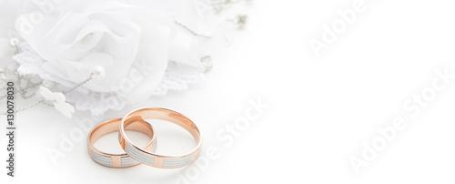 Fényképezés Wedding rings on wedding card on a white background, border design panoramic ban