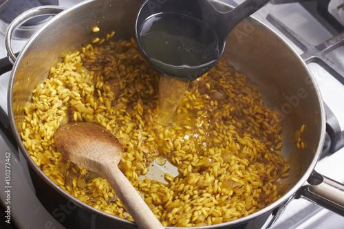 Obraz na płótnie Risotto, Italian rice cooking in a pot