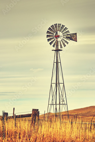 Retro toned windmill tower, American wild west symbol.