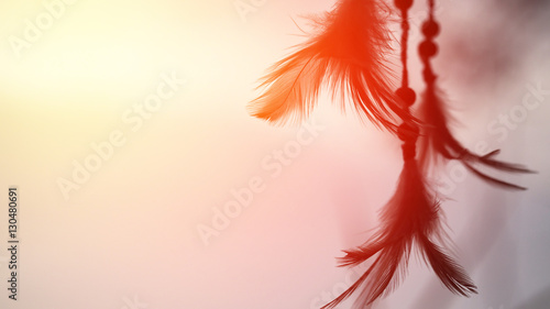 Photo Dream catcher and the rising sun with blurred focus for background,