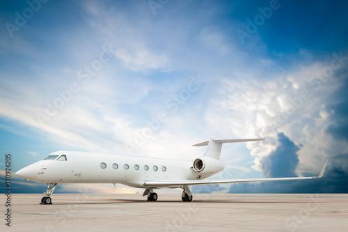 Fototapeta jet plane parked with nice cloud