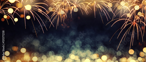Fotografering Gold and dark blue Fireworks and bokeh in New Year eve and copy space