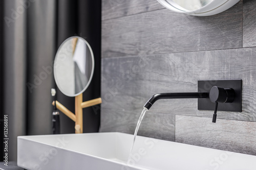Fotografie, Obraz Washbasin with wall mounted tap