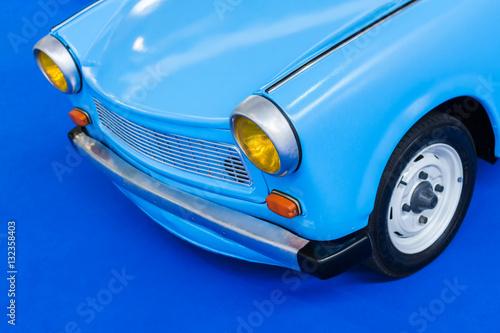 Canvas Print Blue retro east European car on a blue background