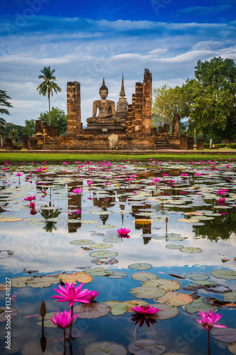 Buddha Statue at Wat Mahathat in Sukhothai Historical Park. Fototapeta