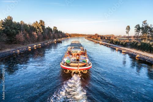 Fotografija inland vessel drives a canal river along