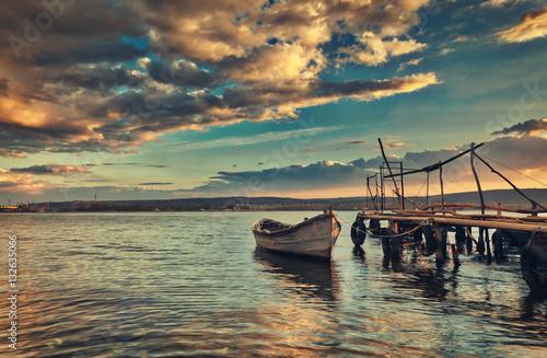 Small dock and fishing boat at fishing village, sunrise shot