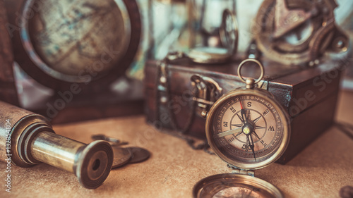 Fotografie, Obraz Antique pirate adventure collection including a compass, telescope, treasure wood box and globe models
