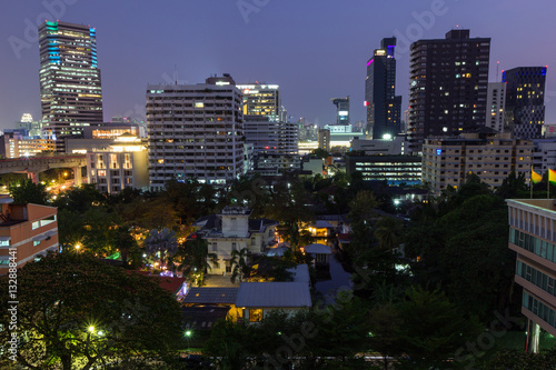 View of skyscrapers and other buildings in Bangkok, Thailand in the evening.