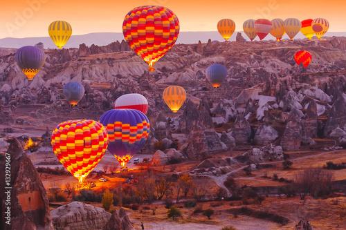 Scenic vibrant view of balloons flight in Cappadocia valley in s