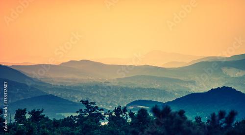 Obraz na płótnie Sunset over the hills
