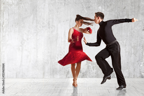 Foto Beautiful couple in the active ballroom dance on wall