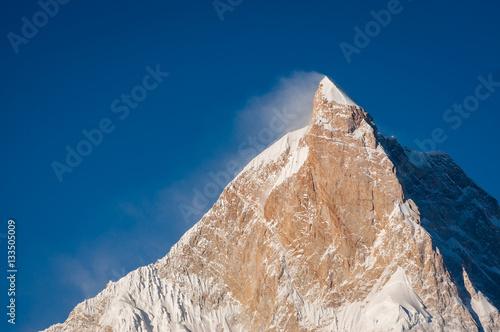 Sunlight on top of Masherbrum mountain peak in a morning, Goro I