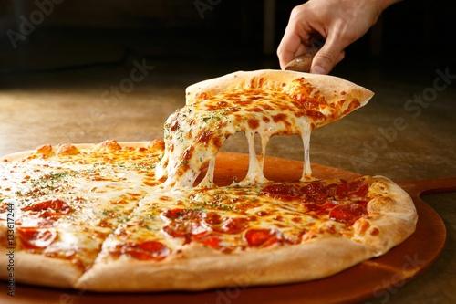 Fototapeta pepperoni pizza on wooden board