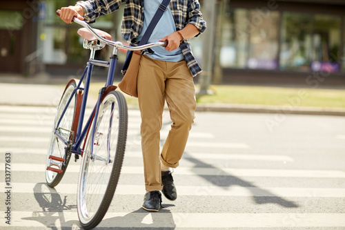 young man with fixed gear bicycle on crosswalk Fototapeta