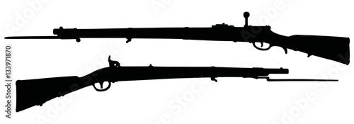Photo Black silhouettes of historical military flintlocks