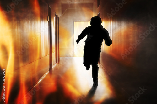 Photo Person Running Out Of Fire Escape