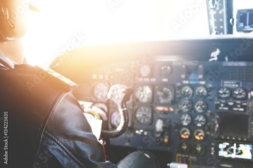 Caucasian aviator piloting airplane Fototapeta