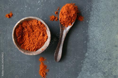 Fotografija Grounded red paprika (chili powder) in a bowl