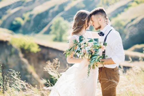Fototapeta bride and groom hugging at the wedding in nature.