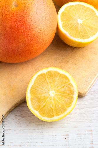 grapefruit and lemon on a white background closeup