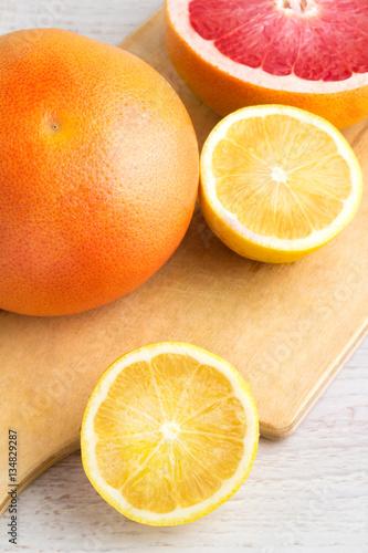 grapefruit and lemon on a white background