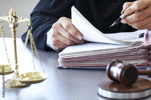 Scales of justice with judge gavel on table Fototapeta
