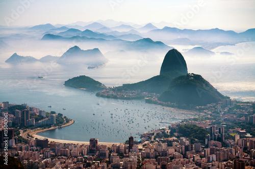 The Sugarloaf mountain in morning mist and Botafogo bay, Rio de Janeiro