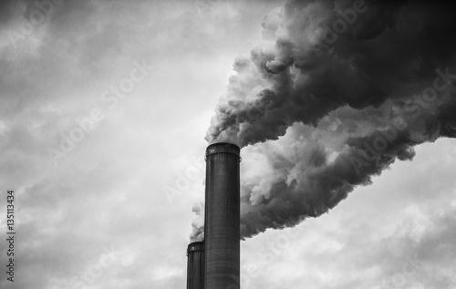 Leinwand Poster Black and White of smoking smokestacks