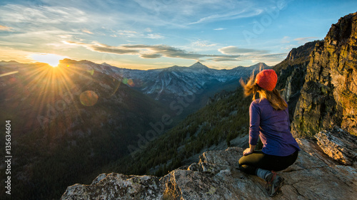 Canvas Print A hiker watches sunset over the Bitteroots from Bear Creek Overlook in the Selway-Bitterroot Wilderness