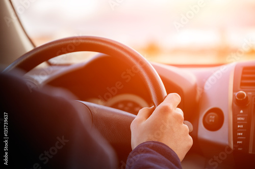 Driving car hands on steering wheel Fototapet