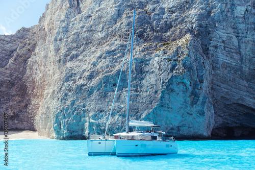 White catamaran in the Blue Lagoon Fotobehang