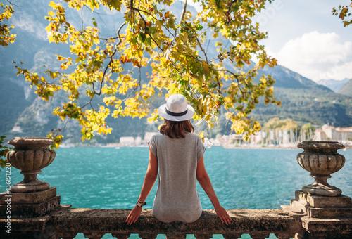 Obraz na plátně Young woman relaxing on beautiful Garda lake