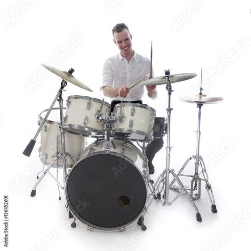 drummer behind drum set wears white shirt and plays the drums Fototapeta