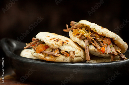 Colombian arepa filled with shredded beef
