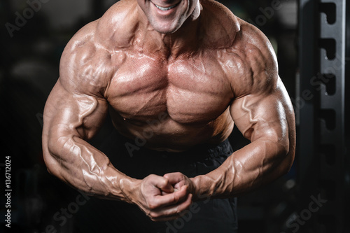 Wallpaper Mural Brutal strong bodybuilder man pumping up muscles and train gym
