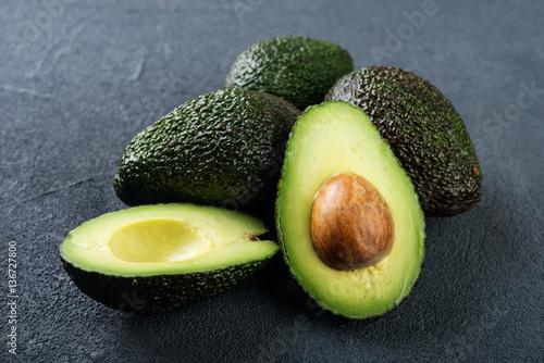 Fresh avocado on dark background. Vegetarian  food concept. Selective focus