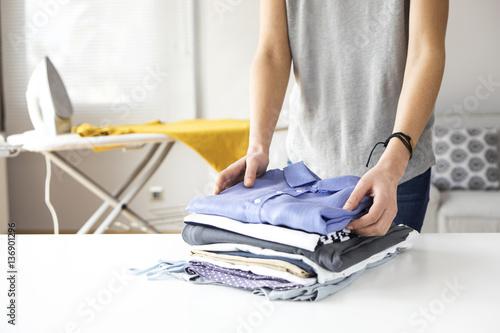 Fotografia, Obraz Ironing clothes on ironing board