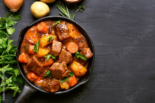 Beef stew with potatoes, carrots and herbs
