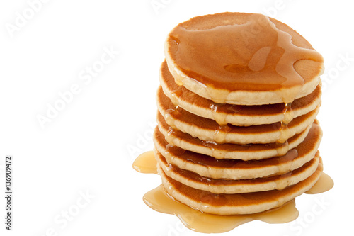 Pancakes with maple syrup isolated on a white background. Breakfast, snacks. Pancakes Day.