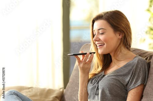Slika na platnu Girl using a smart phone voice recognition