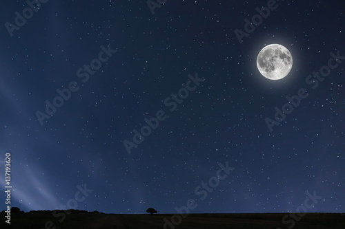 Night sky background with moon and stars. Full moon background.