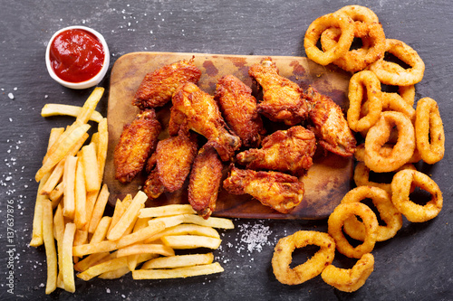 Vászonkép fast food meals : onion rings, french fries and fried chicken