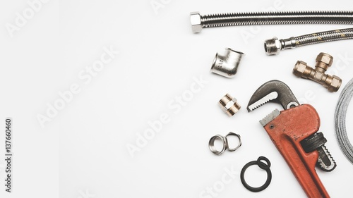 Fotografija plumbing tools and equipment on white background with copy space