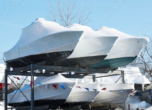 Winterized boats stored on racks