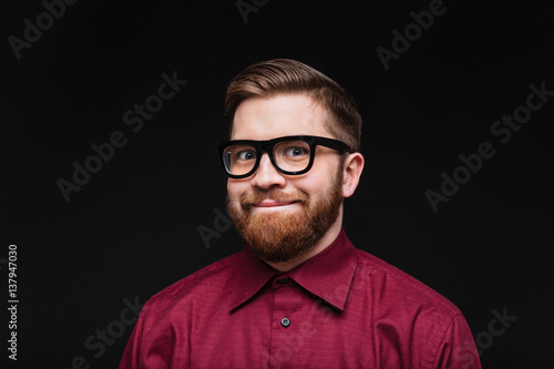Canvas Print Smiling Male nerd in funny eyeglasses