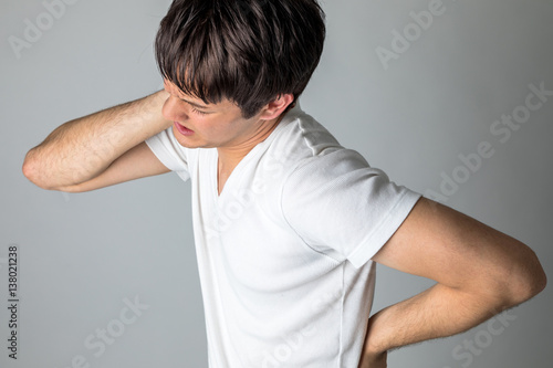 Obraz na płótnie young man having a pain in his neck